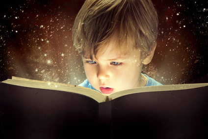 Boy reading with starry sky background
